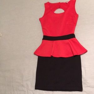 Black and coral peplum dress by BCBGeneration